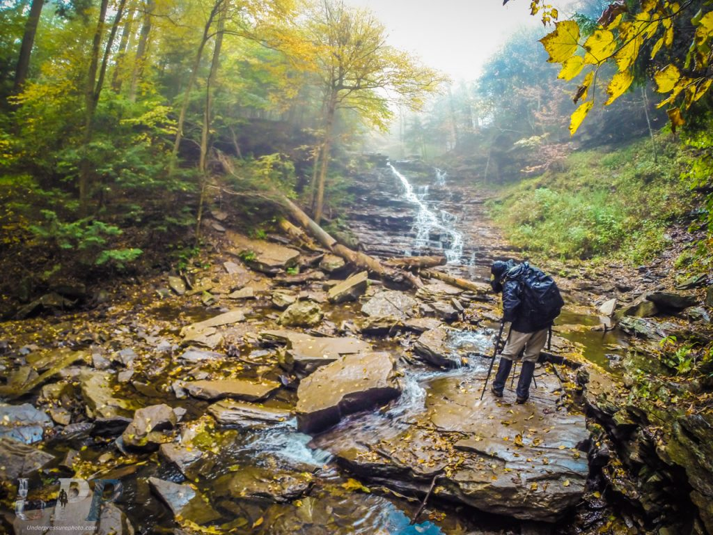 """Scott McGee photographs the F.L. Ricketts Falls in the rain at Ricketts Glen, PA. Photo by <a href=""""http://www.crtrgrl.com>CrtrGrl</a>."""