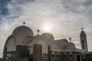 The sun sets over the church at St Antony's Coptic Monastery. It looks like something you'd find on Tatooine.