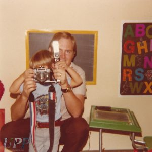 Photo of my Dad and I, with my Dad's camera. Yes, I'm wearing a Superman shirt. I geeked out young.